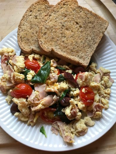 Scrambled eggs with ham, tomato, greens, kalmata olives end product Aug 13, 2017